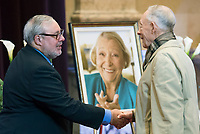 Daniel Payette, left, is greeted by a man during a memorial service for Lise Payette at City Hall in Montreal, Saturday, October 20, 2018. THE CANADIAN PRESS/Graham Hughes