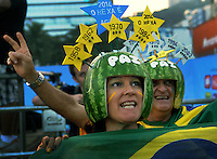 Brazil supporters react during a live broadcast of the soccer World Cup match between Brazil and Mexico<br />  on Copacabana beach, Rio de Janeiro, Brazil, June 17, 2014