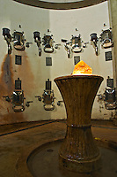 Concrete fermentation vats and the mystic fountain with a big crystal lit from underneath that supposedly give energy to the one who touches it and to the winery. Domaine Viret, Saint Maurice sur Eygues, Drôme Drome France, Europe
