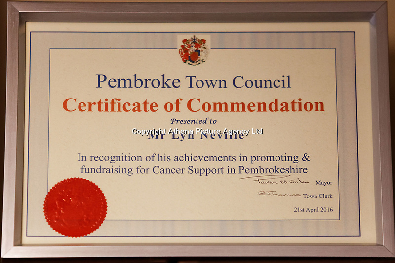 Pictured: A Pembroke Town Council award presented to Lyn Neville of Pembroke, west Wales, UK. Tuesday 20 February 2018<br /> Re: Seven-year-old Elly Neville who was born despite doctors saying her parents would not be able to have any more children, has raised over £150,000 for the cancer ward that treated her father.<br /> Her parents Lyn and Ann had been told they were unlikely to have more children after he underwent a bone marrow transplant in 2005. <br /> Mr Neville subsequently spent a lot of time on the Ward 10 cancer facility at Withybush Hospital in Haverfordwest, Pembrokeshire.<br /> But four years later they were stunned when his painter and decorator wife Ann fell pregnant again.