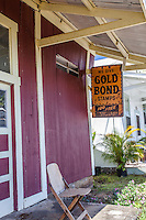 "Old ""Gold Bond Stamps"" sign hanging in front of old store in Honomu, Big Island."