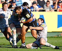 Photo: Richard Lane/Richard Lane Photography. Bath Rugby v Leicester Tigers. Aviva Premiership. 01/10/2011. Bath's Charlie Beech is tackled by Tigers' Ben Woods and Julian Salvi.