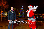 Cllr Mike Foley (Cathaoirleach, Listowel Municipal District) and Santa turn on the Christmas Tree Lights in Listowel on Monday evening.