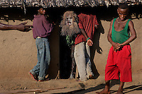 The boys are secluded in this hot mud hot before they do their individual dances thru town, signifying their manhood...The whipping is more severe on the last day and includes a ceremony where the boys are secluded within a phalanx of men all carrying whips... the men are met halfway thru the village with women carrying whips and a melee ensues trying to control the destiny of the child... the men win... the boy is now a man and cannot be claimed as a child anymore by his mother.  There is also ritual scarification on this day and each boy is paraded, one by one thru the village accompanied by a masked elder and someone to collect the money being thrown at his dancing feet...