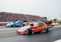 Aug 18, 2018; Brainerd, MN, USA; NHRA funny car driver Courtney Force (near) races alongside father John Force during qualifying for the Lucas Oil Nationals at Brainerd International Raceway. Mandatory Credit: Mark J. Rebilas-USA TODAY Sports
