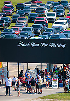 Jul 18, 2020; Clermont, Indiana, USA; NHRA fans enter the spectator entrance for qualifying for the Summernationals at Lucas Oil Raceway. Mandatory Credit: Mark J. Rebilas-USA TODAY Sports