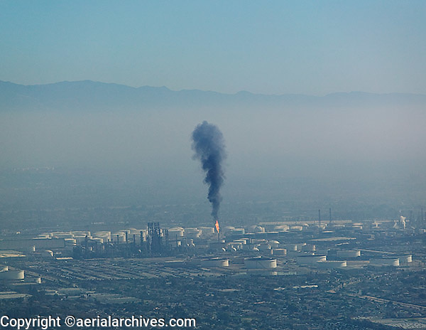 aerial photograph of a flare at a refinery contributing to air pollution in Los Angeles, California