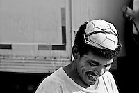 A Brazilian dock worker wears a leather cover of a ball on his head as a protection, Belem, Brazil, 2 March 2004. Amazonia is the world's largest dense tropical forest area. Since the 16th century the original indigenous people have been virtually pushed away or exterminated. The primal ancient unity between tribes and the jungle ambient has changed into a fight between the urban based civilization and the jungle enviroment. Although new generations of white and mestizo settlers have not become adapted to the wild tropical climate and rough conditions, they keep moving deeper into the virgin forest. The technological expansion causes that Amazonia is changing rapidly.
