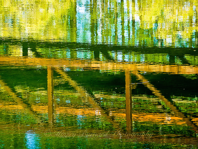 """""""WHITEFISH CROSSING""""<br /> <br /> Autumn reflections of willows, aspen and a bridge over Whitefish River in Whitefish Montana ORIGINAL 24 X 36 GALLERY WRAPPED CANVAS SIGNED BY THE ARTIST $2,500. CONTACT FOR AVAILABILITY."""