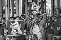 Chicago area postal workers gathered at the James R, Thompson Center to rally to save the postal service from Congressional budget cuts.
