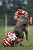 Tackled by Vuga Tagicakibau and Antonio Lavemai, Pirikamu Enua will sustain a season ending injury to his ankle. Counties Manukau Premier Club Rugby game between Karaka and Onewhero, played at Karaka on Saturday June 25th 2016. Karaka won the game 15 - 10 after leading 10 - 3 at halftime.<br />  Photo by Richard Sprnger.