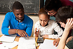 Education High School group of students working together on mathmatics problems