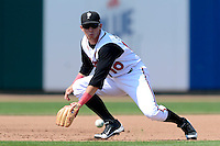 Lansing Lugnuts third baseman Kellen Sweeney (10) during a game against the Dayton Dragons on August 25, 2013 at Cooley Law School Stadium in Lansing, Michigan.  Dayton defeated Lansing 5-4 in 11 innings.  (Mike Janes/Four Seam Images)