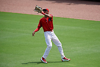 Clearwater Threshers right fielder Jose Pujols (23) settles under a fly ball during the first game of a doubleheader against the Lakeland Flying Tigers on June 14, 2017 at Spectrum Field in Clearwater, Florida.  Lakeland defeated Clearwater 5-1.  (Mike Janes/Four Seam Images)