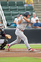 Andrew Pullin (17) of the Lakewood BlueClaws follows through on his swing against the Kannapolis Intimidators at CMC-NorthEast Stadium on July 20, 2014 in Kannapolis, North Carolina.  The Intimidators defeated the BlueClaws 7-6. (Brian Westerholt/Four Seam Images)