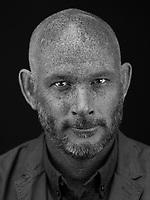 Portrait made using ultraviolet light of VII photographer Danny Wilcox Frazier.