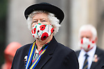 Pictured: A member of the Royal British Legion wears a face mask emblazoned with poppies outside Winchester Cathedral during the VJ Day service in Winchester, Hants. <br /> <br /> Today marks the 75th anniversary of VJ (Victory over Japan) Day, marking both the surrender of Japan and the end of the Second World War.<br /> <br /> © Jordan Pettitt/Solent News & Photo Agency<br /> UK +44 (0) 2380 458800