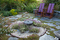 Shelagh Tucker dry, gravel patio garden with thyme groundcovers between stone pavers for patio with chairs, Seattle, Washington