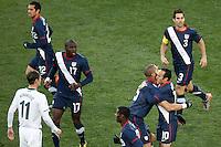 Landon Donovan of USA (right) celebrates his goal against Slovenia