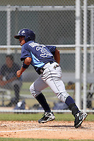 Tampa Bay Rays Juniel Querecuto #39 during a spring training game against the Baltimore Orioles at the Buck O'Neil Complex on March 21, 2012 in Sarasota, Florida.  (Mike Janes/Four Seam Images)