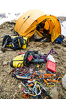 Lucho Birkner at base camp with his route bolting kit ready outside tent, Valle des los Condores, Chile