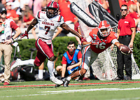 ATHENS, GA - OCTOBER 12: Demetris Robertson #16 of the Georgia Bulldogs reaches unsuccessfully for a pass as Jammie Robinson #7 of the South Carolina Gamecocks defends during a game between University of South Carolina Gamecocks and University of Georgia Bulldogs at Sanford Stadium on October 12, 2019 in Athens, Georgia.