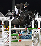 Kevin Staut and Ali 0267 compete for France in the $75,000 FEI Nations Cup, an Olympics-style show jumping event, on Friday night, Feb. 28, 2009, during the Winter Equestrian festival in Wellington, Fla. Canada won the eight-nation, two-round competition before the first sellout (8,000) at the recently-renovated Palm Beach International Equestrian Center. Canada edged Ireland and Great Britain (tie) for the blue ribbons, followed by the United States. Also competing were teams from Argentina, France, Mexico and Venezuela. Thousands of cheering, flag-waving fans packed the International Arena at the WEF grounds for the Nations Cup, reportedly the oldest and most prestigious team show jumping competition in the world. Photo by Bob Markey II