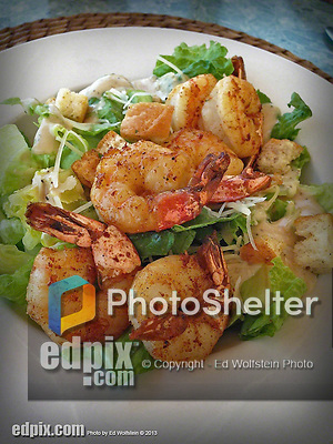 9 July 2013: A shrimp dish is presented for lunch on the oceanside deck at Cobalt Coast Resort, in West Bay, Grand Cayman Island. Located in the British West Indies in the  Caribbean, the Cayman Islands are renowned for excellent scuba diving, snorkeling, beaches and banking.  Mandatory Credit: Ed Wolfstein Photo