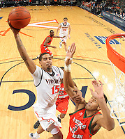 Virginia's Sylven Landesberg(15) leaps over Texas Pan Am's Aaron Urbanus(3) for the dunk during the 72-53 win Tuesday night at the John Paul Jones Arena in Charlottesville, Va. Photo/Andrew Shurtleff