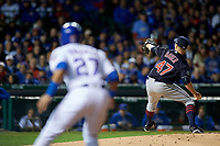 Cleveland Indians pitcher Trevor Bauer (47) delivers a pitch as Addison Russell (27) leads off first base in the second inning during Game 5 of the Major League Baseball World Series against the Chicago Cubs on October 30, 2016 at Wrigley Field in Chicago, Illinois.  (Mike Janes/Four Seam Images)