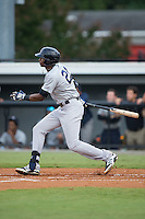 Kendall Coleman (21) of the Pulaski Yankees follows through on his swing against the Burlington Royals at Burlington Athletic Park on August 6, 2015 in Burlington, North Carolina.  The Royals defeated the Yankees 1-0. (Brian Westerholt/Four Seam Images)