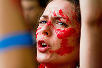 Red painted face of a Quebec students who  demonstate in downtown Montreal to protest the proposed tuition hike, May 22, 2012.<br /> <br /> Photo  : Agence Quebec Presse - Jules Marchetti
