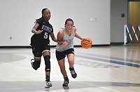 Greenwood's Brooklyn Woolsey (35) drives the ball as Fayetteville's Jayla Johnson (5) follows, Thursday, June 10, 2021 during a basketball game at Rogers High School in Rogers. Check out nwaonline.com/210611Daily/ for today's photo gallery. <br /> (NWA Democrat-Gazette/Charlie Kaijo)