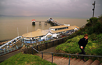 "A man walks up the steps from Mumbles Pier at the seaside village of Mumbles near Swansea, UK. Monday 16 October 2017<br /> Re: Remnants of Hurricane Ophelia are expected to bring strong gusts of wind to Wales when it hits Britain's shores.<br /> The hurricane, making its way from the Azores in the Atlantic Ocean, will have weakened to a storm when it arrives.<br /> A Met Office amber ""be prepared"" warning has been issued in some areas bringing ""potential danger to life""."