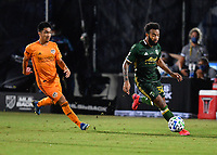 LAKE BUENA VISTA, FL - JULY 18: Eryk Williamson #30 of the Portland Timbers dribbles the ball as he is pursued by Memo Rodríguez #8 of the Houston Dynamo during a game between Houston Dynamo and Portland Timbers at ESPN Wide World of Sports on July 18, 2020 in Lake Buena Vista, Florida.
