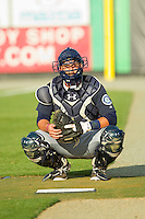 Pulaski Mariners catcher Toby Demello (6) warms up his starting pitcher in the bullpen prior to the game against the Burlington Royals at Burlington Athletic Park on June20 2013 in Burlington, North Carolina.  The Royals defeated the Mariners 2-1 in 13 innings.  (Brian Westerholt/Four Seam Images)