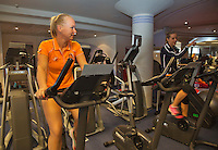 Moskou, Russia, Februari 4, 2016,  Fed Cup Russia-Netherlands,  Dutch team in fitness center, Arantxa Rus and Kiki Bertens (foreground) on the bike<br /> Photo: Tennisimages/Henk Koster