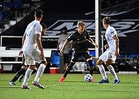 LAKE BUENA VISTA, FL - JULY 18: Bryce Duke #19 of LAFC is pressured by Rolf Feltscher #25 of LA Galaxy during a game between Los Angeles Galaxy and Los Angeles FC at ESPN Wide World of Sports on July 18, 2020 in Lake Buena Vista, Florida.