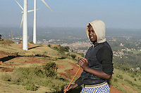 KENYA, Nairobi, Ngong Hills, 25,5 MW Wind Power Station with Vestas and Gamesa wind turbines, owned and operated by KENGEN Kenya Electricity Generating Company, shepherd with sheeps / KENIA, Ngong Hills Windpark, Betreiber KenGen Kenya Electricity Generating Company mit Vestas und Gamesa Windkraftanlagen, junge Hirtin mit Schafen