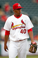 Jorge Rondon (40) of the Springfield Cardinals walks off the field during a game against the Tulsa Drillers at Hammons Field on June 27, 2011 in Springfield, Missouri. (David Welker / Four Seam Images)