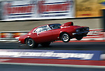 Drag Racing! Camero goes airborn.