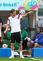 Toni Kroos of Germany balances the ball on his arm during training ahead of tomorrow's semi final vs Brazil