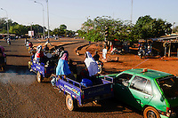 BURKINA FASO , Bobo Dioulasso, street traffic, chinese three-wheeler Apsonic