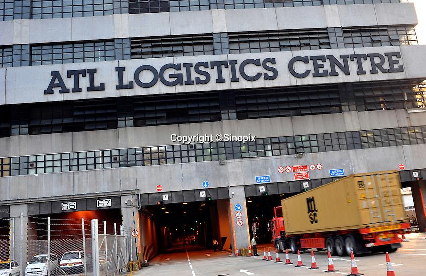 Lorries enter the ATL logistics centre for export at the Hong Kong container terminal, Hong Kong. Hong Kong has seen a near 20% decrease in exports since the financial crisis..