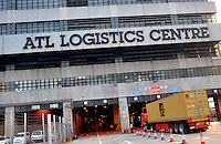 Lorries enter the ATL logistics centre for export at the Hong Kong container terminal, Hong Kong. Hong Kong has seen a near 20% decrease in exports since the financial crisis..