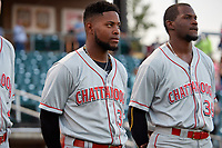 Chattanooga Lookouts Alfredo Rodriguez (35) and Michael Beltre (39) during the national anthem before a Southern League game against the Birmingham Barons on May 2, 2019 at Regions Field in Birmingham, Alabama.  Birmingham defeated Chattanooga 4-2.  (Mike Janes/Four Seam Images)