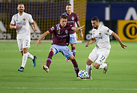 CARSON, CA - SEPTEMBER 19: Sebastian Lletget #17  of the Los Angeles Galaxy moves with the ball past Cole Bassett #26 of the Colorado Rapids during a game between Colorado Rapids and Los Angeles Galaxy at Dignity Heath Sports Park on September 19, 2020 in Carson, California.