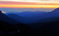 Sunrise silhouettes mountain ridges as seen from Hurricane Ridge Viewpoint.