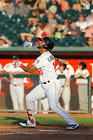 Lansing Lugnuts outfielder Freddy Rodriguez (31) follows through on a swing during a game against the Dayton Dragons at Cooley Law School Stadium on August 10, 2018 in Lansing, Michigan. Lansing defeated Dayton 11-4.  (Robert Gurganus/Four Seam Images)