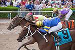 Holywell with Orlando Bocachica (on rail yellow cap) gets by Moment of Delight (red cap) to win the $250,000 Susan's Girl Stakes. Gulfstream Park,  Hallandale Beach (FL). 09-06-2014. Arron Haggart/ESW/CSM